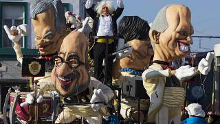 Giant figures depicting Belgian Prime Minister Charles Michel (C) and other politicians are seen during the 87th carnival parade of Aalst February 15, 2015.
