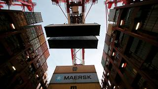 FILE PHOTO: Containers are seen unloadedat the Yangshan Deep Water Port, part of the Shanghai Free Trade Zone, in Shanghai, China, September 24, 2016.