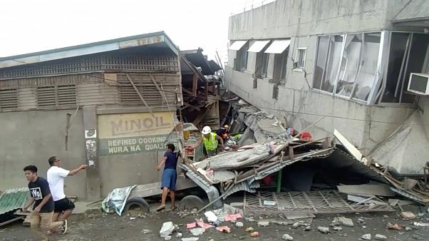 Rescue crew members look for trapped victims at collapsed building at Padada market, in Padada Philippines December 15, 2019