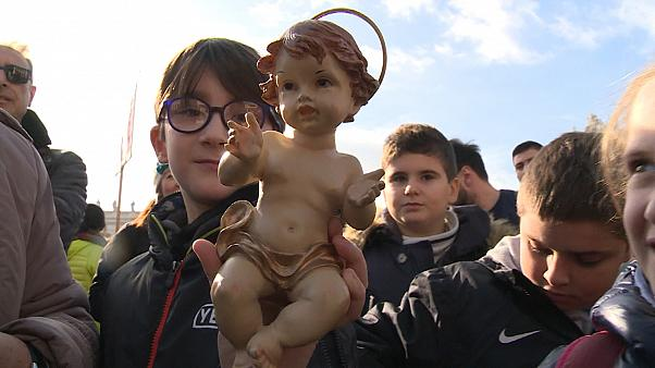 Pope Francis blesses baby Jesus statues during Angelus