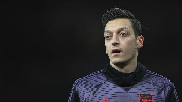Arsenal footballer Mesut Ozil 'misled' over Uighurs, says China