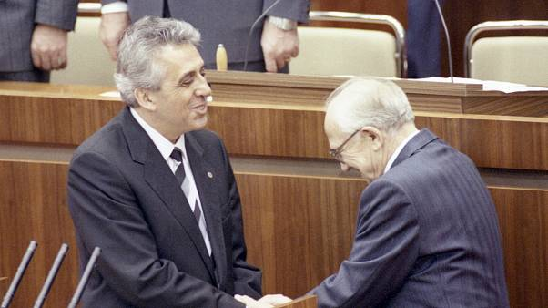 Newly elected Egon Krenz shown with President of the People's Chamber, Horst Sindermann on Oct. 24, 1989. (AP Photo/Rainer Klostermeier)