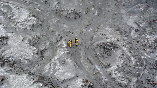 Rescuers on White Island off the coast of New Zealand's North Island