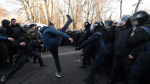 Activists of Ukrainian far-right movements clash with police forces during a protest against land sale reform in front of the Parliament in Kiev on December 17, 2019.
