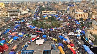 Anti-government protesters gather in Tahrir Square during ongoing protests in Baghdad, Iraq, Tuesday, Dec. 10, 2019. (AP Photo/Ali Abdul Hassan)