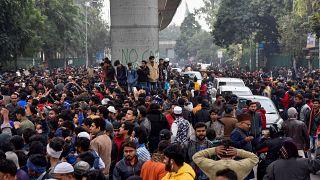 Protesters outside Jamia Millia Islamia university in Delhi