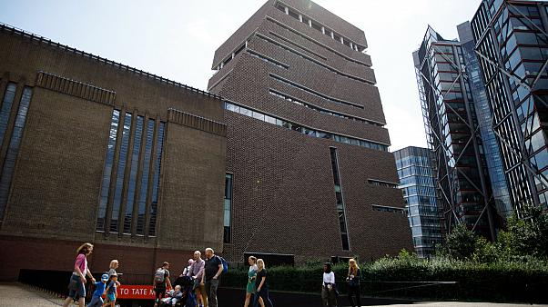 People walk past the Tate Modern gallery on August 5, 2019, the day after a six-year-old boy was thrown from a tenth-floor viewing platform.