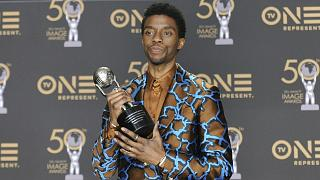 Chadwick Boseman, a cast member in Black Panther, poses at the premiere of the film in Los Angeles.