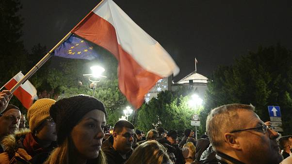 Demonstrators hold a rally to protest against changes to Poland's judiciary planned by the ruling Law and Justice party near the building of parliament in Warsaw, Poland.