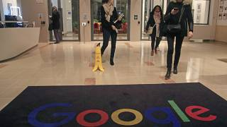 Google employees walks out of the entrance hall of Google France in Paris, Monday, Nov. 18, 2019. (AP Photo/Michel Euler)