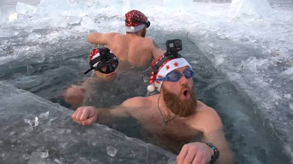 Russian ice divers put up New Year's tree in Lake Baikal