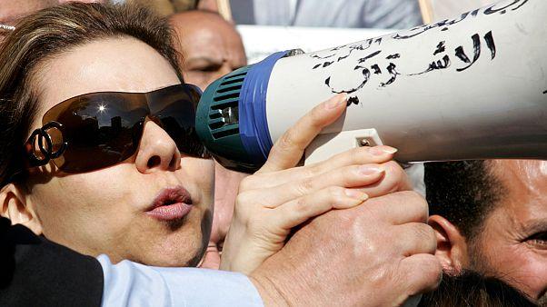رغد صدام حسين خلال احتجاج ضدّ قرار المحكمة العراقية بإعدام والدها في عمان - الأردن