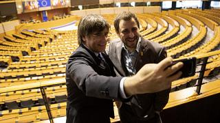 Carles Puigdemont, left, and former Catalan regional minister Antoni Comin take a selfie overlooking the plenary chamber at the European Parliament.