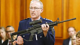 Police chief Mike McIlraith shows New Zealand MPs an AR-15 style rifle similar to one of the weapons a gunman used to kill 51 worshippers at two New Zealand mosques