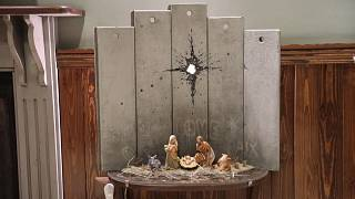 Artist Banksy unveils dark nativity in Bethlehem