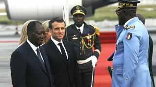 French President Emmanuel Macron is welcomed by President Alassane Ouattara upon arrival in Abidjan, Ivory Coast, Friday dec. 20, 2019 for a three-days official visit.