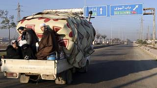 A family flees toward Turkey from Idlib as Syrian government forces shell the region