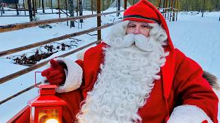 A man dressed as Santa Claus poses for a picture near Santa Claus Office located on the Arctic Circle near Rovaniemi