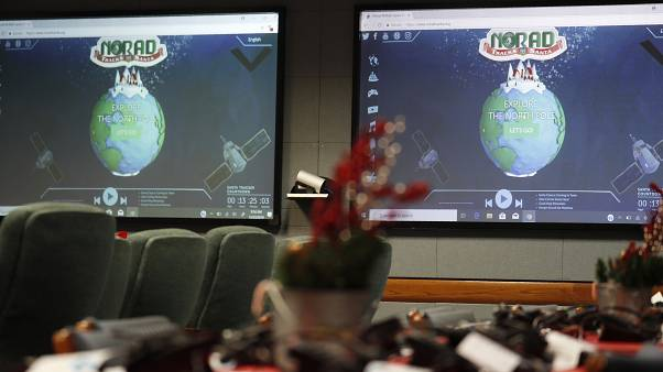 Monitors are illuminated in the NORAD Tracks Santa center at Peterson Air Force Base