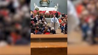 Irish priest on wheels scoots out of Christmas Eve mass