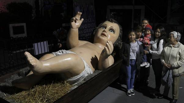 Mexicans visit giant baby Jesus statue to toast Christmas