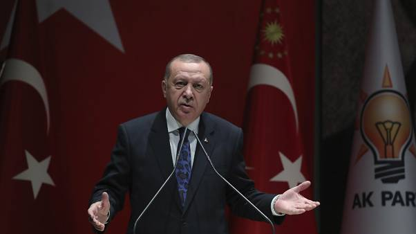 Turkey's President Recep Tayyip Erdogan addresses the members of his ruling party, in Ankara, Turkey, Thursday, Dec. 26, 2019.