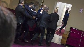 Police officers carry a pro-Serb opposition lawmaker in the parliament building in Podgorica, Montenegro, Friday, Dec. 27, 2019.