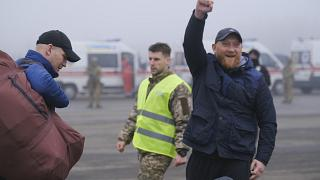 A pro-Russian prisoner celebrates during an exchange close to the Maiorske checkpoint, Donetsk.