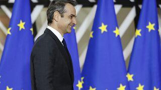 Greek Prime Minister Kyriakos Mitsotakis arrives for an EU summit in Brussels, Thursday, Dec. 12, 2019.