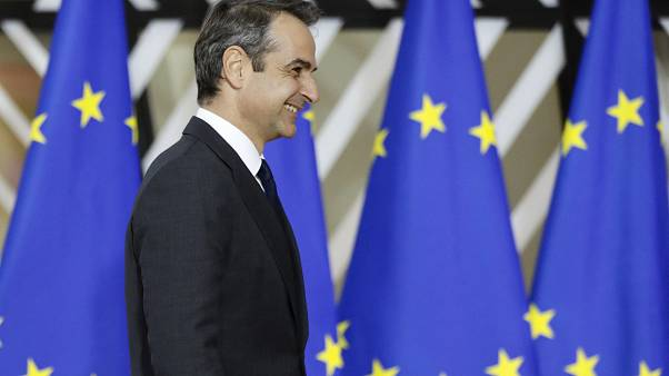 Greek Prime Minister Kyriakos Mitsotakis arrives for an EU summit in Brussels, Thursday, Dec. 12, 2019.