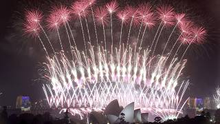 In this Sunday, Jan. 1, 2017 photo, fireworks explode over the Sydney Opera House and Harbour Bridge as New Year's celebrations are underway in Sydne. (AP Photo/Rick Rycroft,