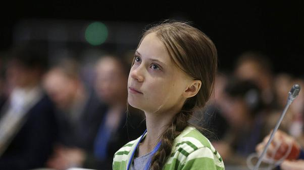 Swedish climate activist Greta Thunberg listens to speeches before addressing a plenary of UN climate conference at the COP25 summit in Madrid, Spain