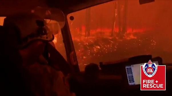 Terrifying moment as Australian firefighters drive through flames
