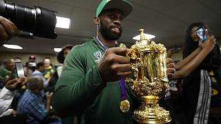 South African Springbok rugby captain Siya Kolisi with the Web Ellis trophy arrives back on home soil at the O.R. Tambo Airport in Johannesburg Tuesday, Nov. 5, 2019.