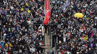 Hong Kong people participate in their annual pro-democracy march to insist their five demands be matched by the government in Hong Kong.