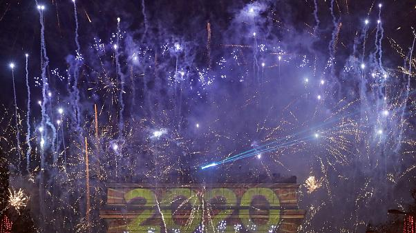 Fireworks set to mark the New Year explode over the Arc de Triomphe on the Champs Elysees,