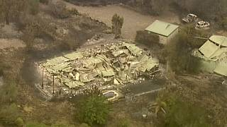 In this image made from video, an aerial scene shows destroyed properties after a wildfire in East Grippsland, Victoria, Wednesday, Jan. 1, 2020.