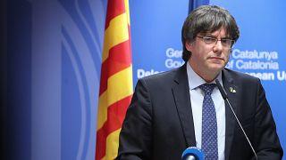Carles Puigdemont: Belgian judge suspends arrest warrant for Catalan leader