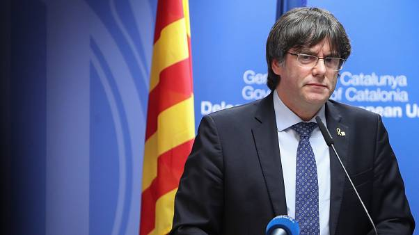Carles Puigdemont: Belgian judge suspends arrest warrant for Catalan leader