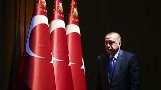Turkey's President Recep Tayyip Erdogan arrives to deliver a speech at an event in Ankara, Monday, Dec. 30, 2019