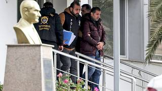 The unidentified suspects were pictured being detained by police in Istanbul