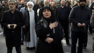 A woman mourns in a demonstration over the U.S. airstrike in Iraq that killed Iranian Revolutionary Guard Gen. Qassem Soleimani in Tehran, Iran, Jan. 3, 2020.