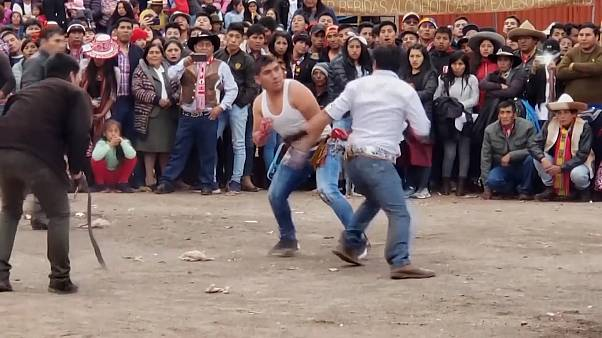 These Peruvians have a fight to welcome in the new year