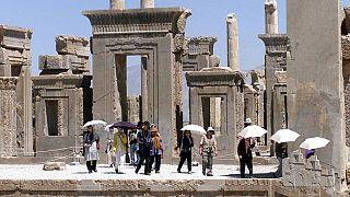 Japanese tourists visit Iran's Persepolis, 460 miles south of Tehran