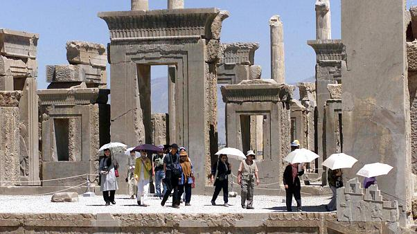 Japanese tourists visit Iran's Persepolis, 460 miles south of Tehran