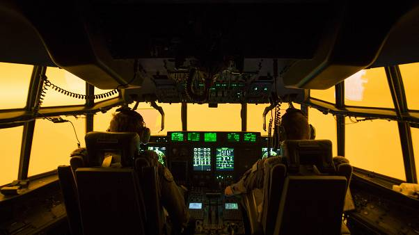 The flight deck of a C-130J Hercules aircraft prepares to land at Merimbula airfield to deploy Fire and Rescue crews.