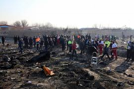 Rescue teams work at the scene after a Ukrainian plane carrying 176 passengers crashed near Imam Khomeini airport in the Iranian capital Tehran on January 8, 2020.