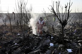 The rescue workers search the scene where a Ukrainian plane crashed in Shahedshahr southwest of the capital Tehran, Iran, Wednesday, 8 January 2020