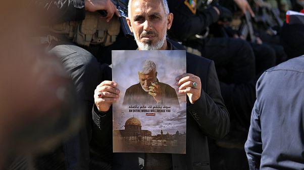 Mourners at funeral of Iranian General Qassem Soleimani
