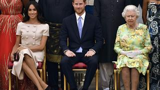 Queen Elizabeth II with the Duke and Duchess of Sussex at the Queen's Young Leaders Awards Ceremony at Buckingham Palace, London, Tuesday June 26, 2018.